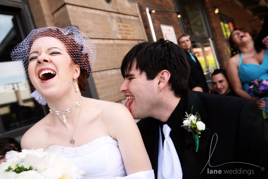 I can't remember what the joke was that led this moment occuring, but I love the photo.  The bridesmaid in the background completely makes it.